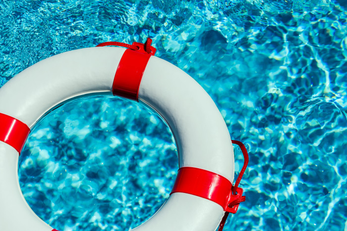 a life ring floating in a pool. symbolic photo for rescue and crisis management in financial and business crisis. Business diagnostics blog image